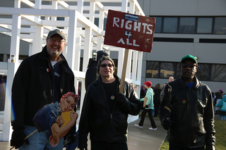 Three men attend the protest in downtown Syracuse. While the protest is called the Women's March, the demonstration was not just for women.