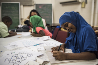 A girl works on math problems during RISE's after-school program, which runs Monday to Thursday.